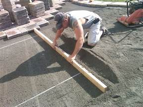 Laying Paver Patio by Brick Pavers Canton Plymouth Northville Novi Michigan