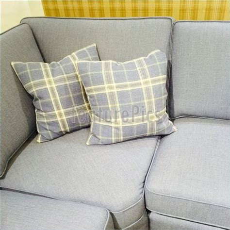 cushions for grey couch checked cushions on gray sofa stock picture i4415433 at