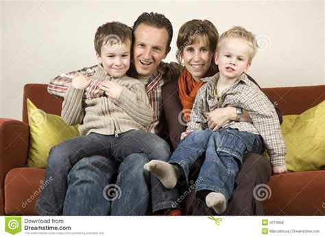 couch family family on a couch 2 royalty free stock photos image 4173958