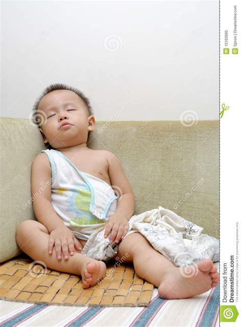 sleeping with baby on couch sleeping baby stock photo image 15103900