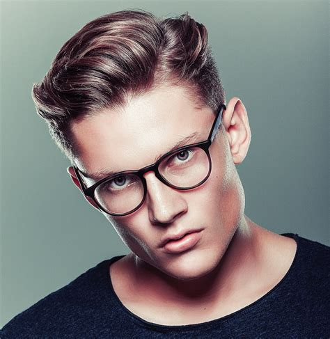 young gentlemans hairstyle side part haircuts