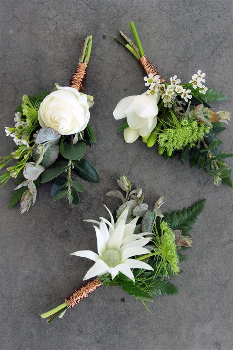 industrial buttonholes  white orchid floral design