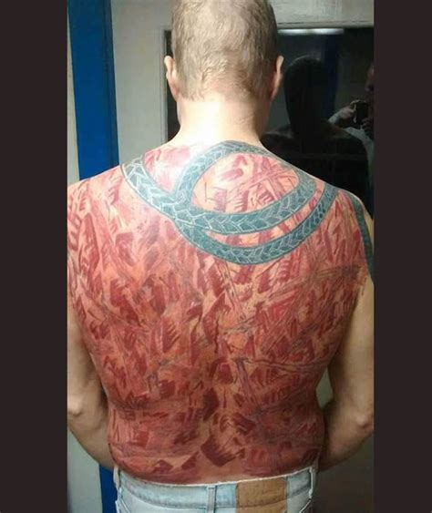 k town tattoo had friends whip his back and then had