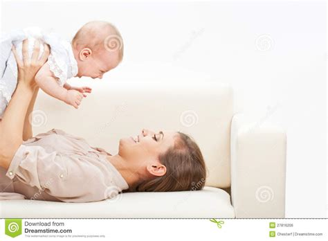 baby on couch mother and baby laying on sofa royalty free stock image