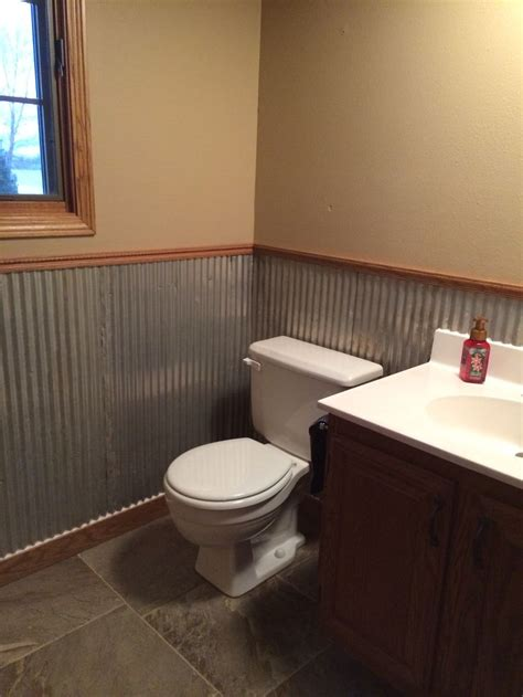 Metal Wainscoting Ideas by Galvanized Tin Used As Wainscoting In Half Bath