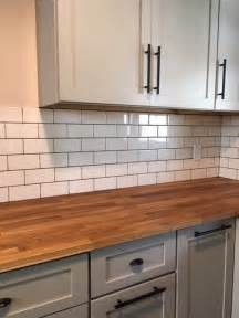 subway tile backsplash meets butcher block countertop