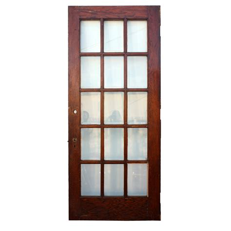Salvaged 34 5 8 Exterior Oak Door With Beveled Glass Salvaged Glass Doors