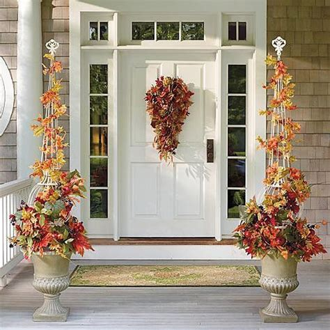 outdoor christmas topiary ideas falling leaves topiary in urn arrangement traditional outdoor decorations