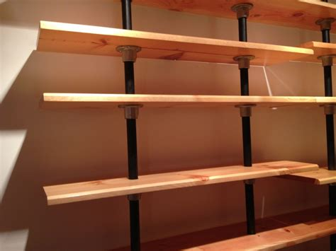 pipe shelves built from reclaimed bookshelves