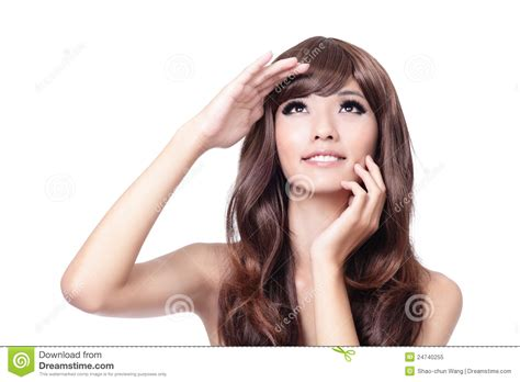 youngest looking women young woman touching her face and looking up stock image