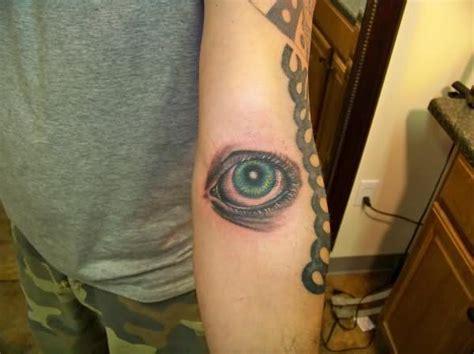 extreme eye tattoo extreme eye graveyard tattoo on arm