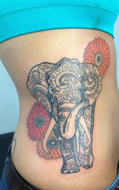 37 elephant tattoos on side rib