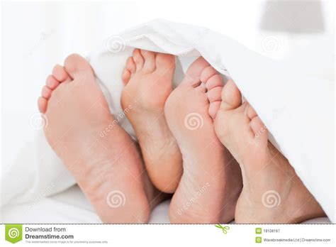 feet in bed family s feet in the bed royalty free stock photography image 18108167