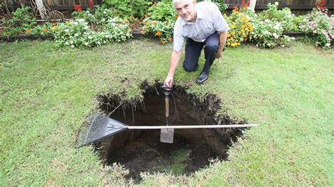 sinkhole in backyard airport link tunnel gives in the backyard as sink