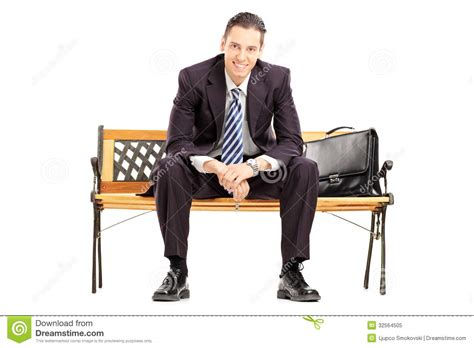 bench for sitting smiling young businessman sitting on a wooden bench