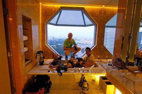 sitting bathtub singapore three photographers sitting in a bathtub