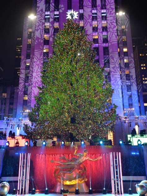 christmas tree lights up in manhattan new york city 8