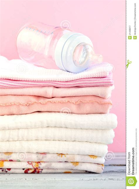 In The Bottle By Maxcyber Cloth baby bottle and pink clothes royalty free stock
