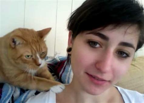 cat massaging gives his human a shoulder
