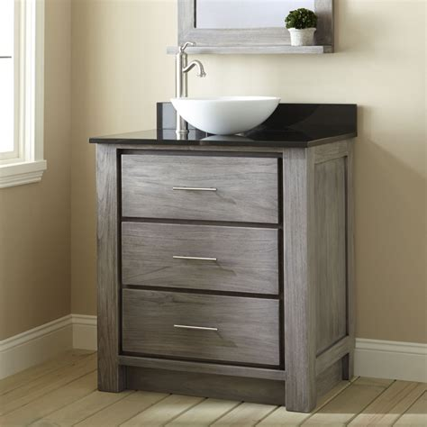 bathroom vanity with bowl on top