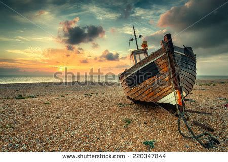 pebble art fishing boat fishing boat on beach stock images royalty free images