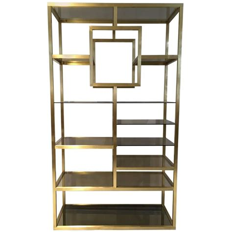 mid century modern polished brass shelving attributed to