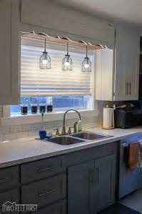 Stunning lantern style kitchen pendant lighting over island