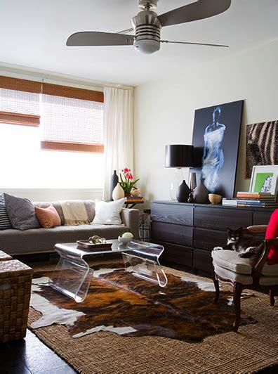 Living Room With Cowhide Rug - happyroost cowhide rugs
