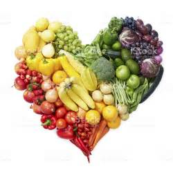 various fruits and vegetables forming heart shape stock