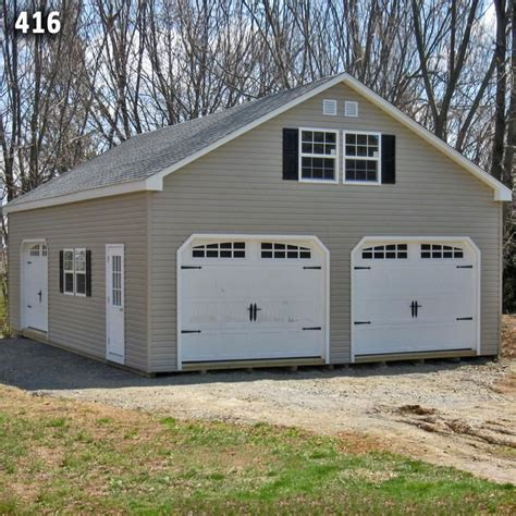 how to build a two story garage 24x36 2 car 2 story garage vinyl siding a frame roof carriage doors build me a garage