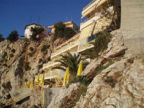 one perched on a rock a biography of dr warren carroll books hotel is perched on a cliff picture of hotel liro vlore