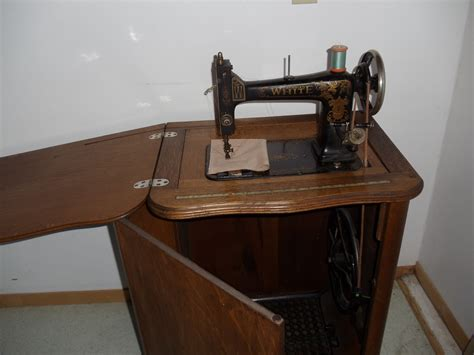white treadle sewing machine in oak cabinet collectors