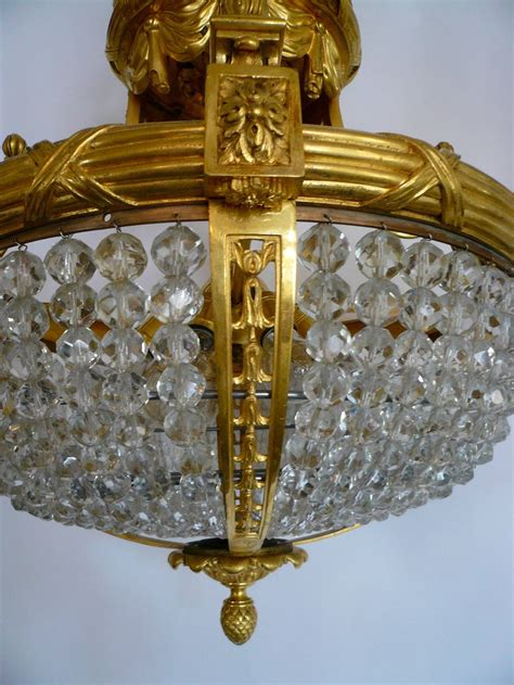 Gilt Bronze And Crystal Bead Eight Light Chandelier By E F Caldwell Lights