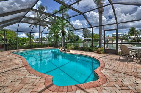 Enclosed Backyard Pools Swimming Pool Screen Enclosed Pool Accented With Pavers
