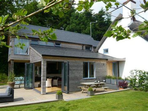 thatched cottage and garden rooms contemporary wood room extension to thatched cottage in