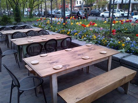 flowers and tulips around an outside patio at
