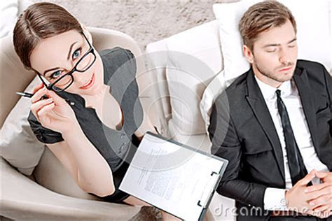 armchair psychologist young man with his psychologist stock photo image 55595925