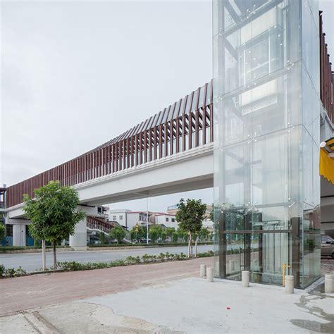 Schlaich Bergermann Und Partner adarc abstracts forms of houses to shape wooden footbridge