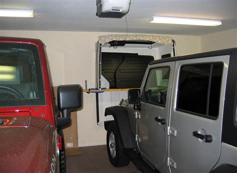 jeep wrangler storage ideas 4 door wrangler jk freedom top hanger diy jeepfan com