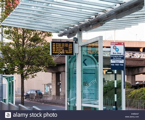 a bus stop shelter outside birmingham airport arrivals