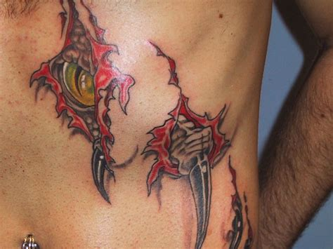 dragon tattoo ripping through skin 26 unique tattoos for men which look fancy