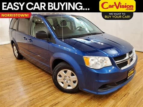 pre owned  dodge grand caravan express fwd