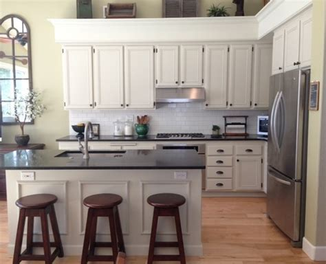 beige kitchen cabinets beige kitchen cabinets with white subway tile design do