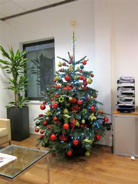 corporate christmas tree red green and gold decorations