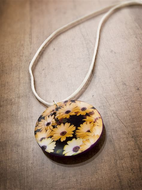 easy to make jewelry make your own necklace with a seed packet mod podge rocks