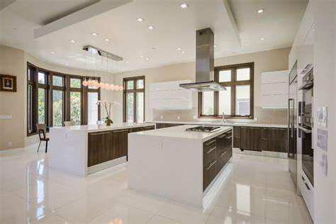 Stainless steel appliances and two islands with prep area Contemporary Kitchen San