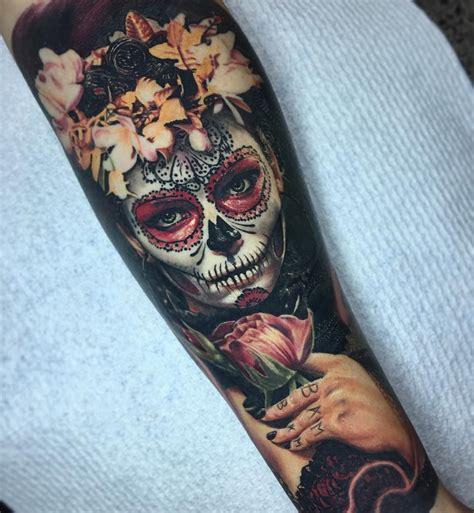 flowery day of the dead forearm piece best tattoo design