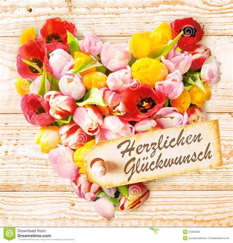 How To Wish Happy Birthday In German German Birthday Wishes On A Colourful Floral Heart Stock