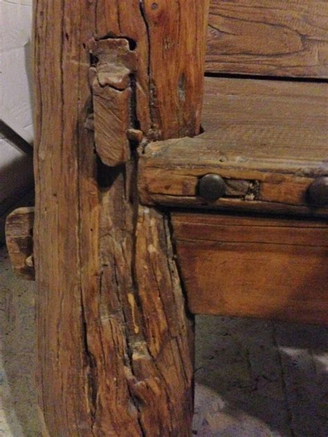 rustic log bench  iron studs antique solid wood