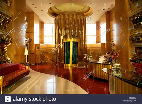 the gold interior reception and elevator area of the seven